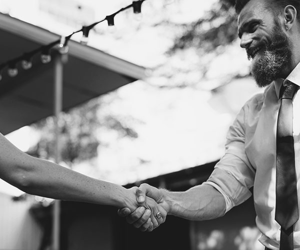 Image of a man shaking hands with another person